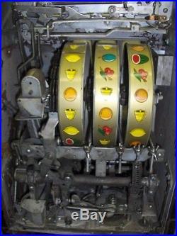 VINTAGE MILLS WATER MELLON BELL SLOT MACHINE 10 CENT TOKEN JACKPOT
