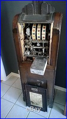 Vintage 1930's Mills Extraordinary Slot machine 25 cent casino arcade skyscraper