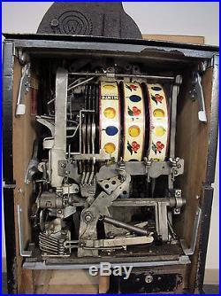 Watling Rol-a-top Castle Front Quarter Slot Machine, Circa 1948