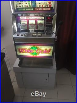 White Gold Ballys Token Slot Machine With Cabinet Stand